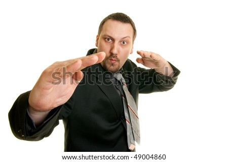 kung fu businessman ready to attack - stock photo