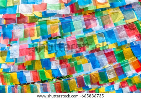 Kunming,China - April 9,2017 : Colorful Tibetan prayer flags in the Tibetan village which is located at Yunnan Nationalities Village, China.