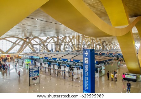Kunming,China - April 22,2017:Traveler can seen exploring and walking around the Kunming Changshui International Airport.It is the primary airport serving Kunming,the capital of Yunnan Province,China.