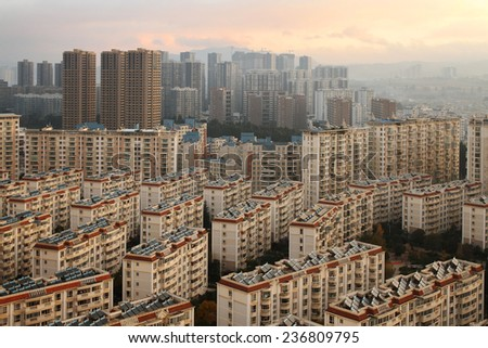 KUNMING, CHINA - DECEMBER 10: Construction on the outskirts of China's major cities, December 10, 2014, Kunming, China. China's economic boom leaves a trail of ghost cities. - stock photo