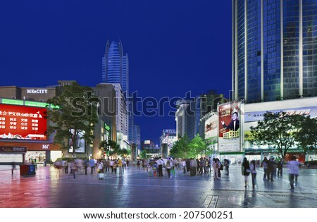 KUNMING-JULY 1, 2014. Nan Ping Jie Shopping area at night. Nanping Shopping Mall area has become a new landmark of Kunming city that attracts a large number of local residents as well as tourists.
