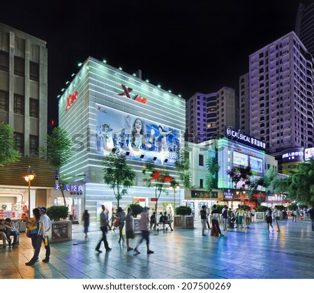KUNMING-JULY 8, 2014. Nan Ping Jie Shopping area at night. Nanping Shopping Mall area has become a new landmark of Kunming city that attracts a large number of local residents as well as tourists. - stock photo