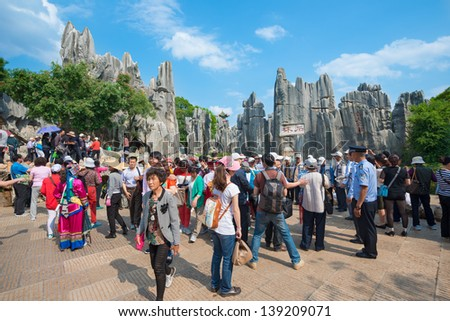 KUNMING - OCT 1: crowd of people travel during national holiday on October 1, 2012 in Kunming, China. More than 20.000 people visit sites like the Kunming Stone Forest daily.