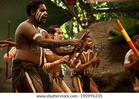 KURANDA, AUSTRALIA - APRIL 18: unidentified aborigines actor at a  performance in the Tjapukai Culture Park on April 18, 2009 in Kuranda, Queensland, Australia - stock photo