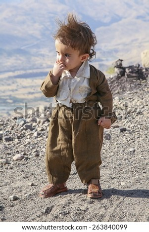 KURDISTAN - OCTOBER 14, 2007: Unidentified little boy in a mountainous region of Kurdistan. - stock photo