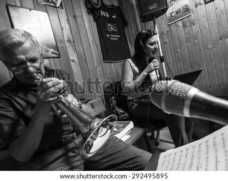 KURSK, RUSSIA - June 21, 2015:  Singer and Victor Elvira Ungureanu Domyshev (Victor Hermann) trumpet, flugelhorn -- Jazz composer Igor Besschastny group rehearses - stock photo