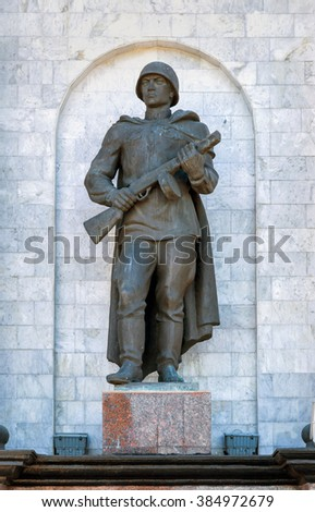 Kursk, Russia - October 1, 2015: Triumphal arch in memorial complex Battle of Kursk. Fragment. Sculpture of the Russian soldier. - stock photo