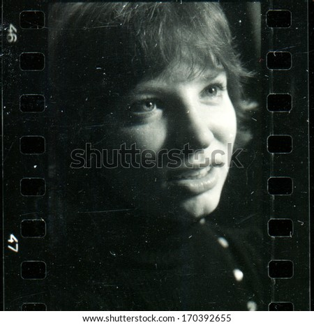 KURSK, USSR - CIRCA 1976: Vintage black and white studio photograph - young woman in black, contact print off 35 mm Svema film, taken by Praktica super TL camera with Tessar 50mm/2.8 lens  - stock photo