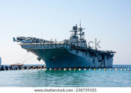 KUSADASI, TURKEY - OCTOBER 06, 2014:  Assault ship, an aircraft carrier. Turkish multi purpose Landing Helicopter Dock. Class L-61,  Juan Carlos I  variant - stock photo
