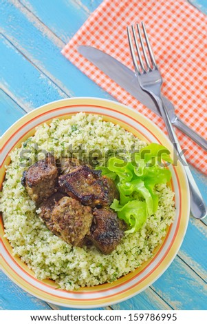 kuskus with fried meat - stock photo