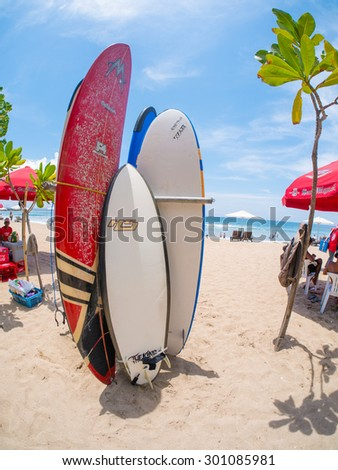 KUTA BALI - INDONESIA, JULY 20 : Surfboards on the famous beach on Kuta in Bali Indonesia July 20th, 2015 - stock photo
