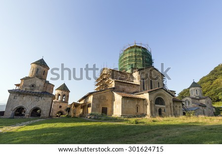 KUTAISI-GELATI, GEORGIA - JULY 24, 2015: The Gelati Monastery complex near Kutaisi, It contains the Church of the Virgin founded by the King of Georgia David the Builder in 1106. - stock photo