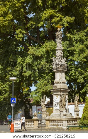 KUTNA HORA, CZECH REPUBLIC - AUGUST 26, 2015: A tall monument at the entrance to the crucifixion in the ossuary in Sedlec Kostnice contain Skeletons about 50,000 People. Kutna Hora