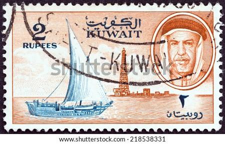 KUWAIT - CIRCA 1959: A stamp printed in Kuwait shows Sheikh Abdullah, dhow and oil derrick, circa 1959.  - stock photo