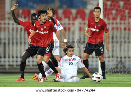 KUWAIT CITY, KUWAIT - SEPTEMBER 13: R.Coutinho of Kuwait during in AFC Cup between Kuwait Fc(W) and Muang Thong UTD(R) on September 13, 2011 at Kuwait Sportclub Stadium in Kuwait City, Kuwait