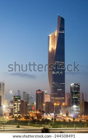 KUWAIT- DECEMBER 10: Tallest building in Kuwait City - the Al Hamra Tower at dusk. December 10, 2014 in Kuwait City, Middle East - stock photo