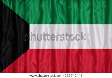 Kuwait flag pattern on the fabric texture , vintage style - stock photo