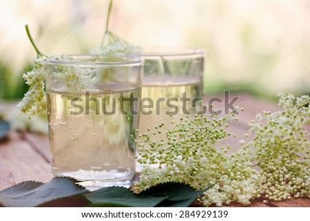 Kvass from elder flowers in a glass - stock photo