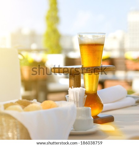 Kwak beer on the served table. Outdoors photo. - stock photo
