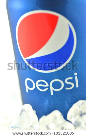 KWIDZYN, POLAND - MARCH 11, 2014: Pepsi drink in a can on ice isolated on white background.  Pepsi is carbonated soft drink produced by PepsiCo. Pepsi  was created and developed in 1893