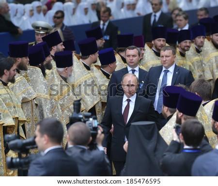 KYIV - JUL 27: President of Russia Vladimir Putin attend a ceremony marking the 1,025th anniversary of the Christianization of Kievan Rus in Kiev, Ukraine. July 27, 2013. - stock photo