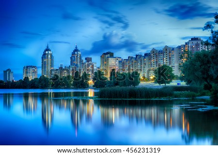 Kyiv. Late evening on the bank of Dnieper river at Obolonskaya Embankment. Capital of Ukraine, Kiev. - stock photo
