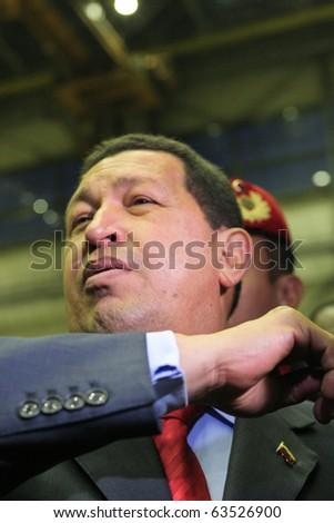 "Kyiv - OCT 18, 2010: President of Venezuela Hugo Chavez during a state visit to Ukraine, on Aircraft Plant ""Antonov"" ASTC, October 18, 2010 in Kyiv, Ukraine. - stock photo"