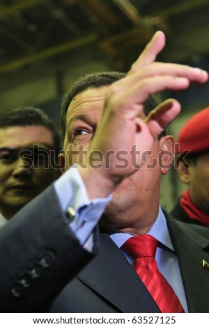 "Kyiv - OCT 18, 2010: President of Venezuela Hugo Chavez during a state visit to Ukraine, on Aircraft Plant ""Antonov"" ASTC, October 18, 2010 in Kyiv, Ukraine. - stock photo"