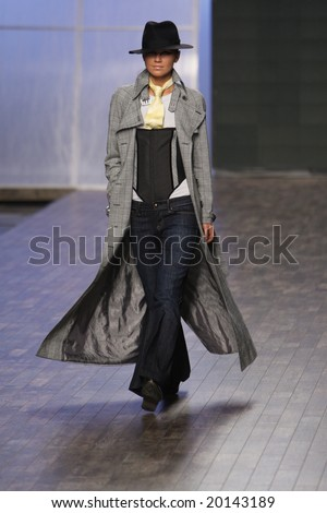 "Kyiv - October 15, 2008: Model walks the runway during Fashion Show by ""VICTORIA GRES DENIM"" as part of Ukrainian Fashion Week October 15, 2008 in Kyiv, Ukraine."