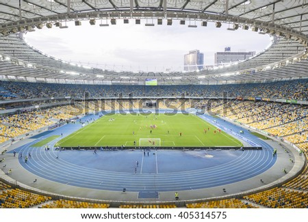 KYIV, UKRAINE - APRIL 10, 2016: Interior of NSC Olympic stadium (NSC Olimpiyskyi) during Ukraine Premier League game FC Dynamo Kyiv vs FC Volyn in Kyiv, Ukraine - stock photo