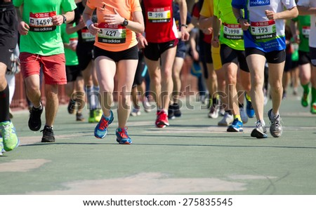 KYIV, UKRAINE - APRIL 26, 2015:Kiev half marathon in Kyiv, Ukraine. The number of runners were more than six thousand people . - stock photo
