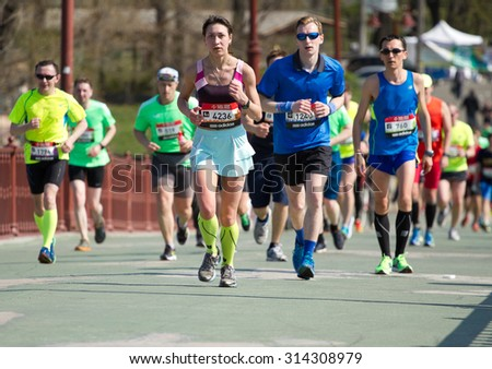 KYIV, UKRAINE - APRIL 26, 2015:Kiev half marathon in Kyiv, Ukraine. The number of runners were more than six thousand people . - stock photo
