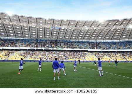 KYIV, UKRAINE - APRIL 14: Players run during training session before Ukraine Championship game between FC Dynamo Kyiv and Vorskla Poltava at NSC Olimpiyskiy stadium on April 14, 2012 in Kyiv, Ukraine - stock photo