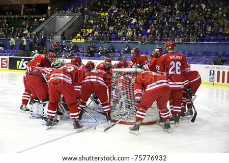 KYIV, UKRAINE - APRIL 20: Poland players cheer each other up during IIHF Ice-hockey World Championship DIV I Group B game against Ukraine on April 20, 2011 in Kyiv, Ukraine - stock photo
