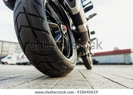 Kyiv, Ukraine - April 27th, 2016: Rear wheel of Red motorcycle Ducati Hyperstrada at the city street.
