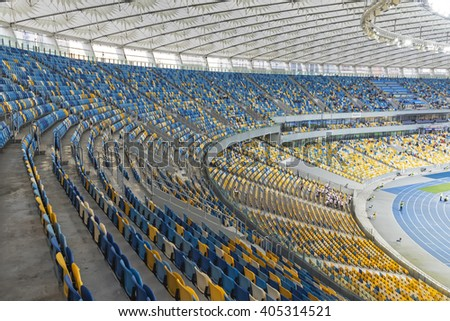 KYIV, UKRAINE - APRIL 10, 2016: Tribunes of NSC Olympic stadium (NSC Olimpiyskyi) during Ukraine Premier League game FC Dynamo Kyiv vs FC Volyn in Kyiv, Ukraine - stock photo