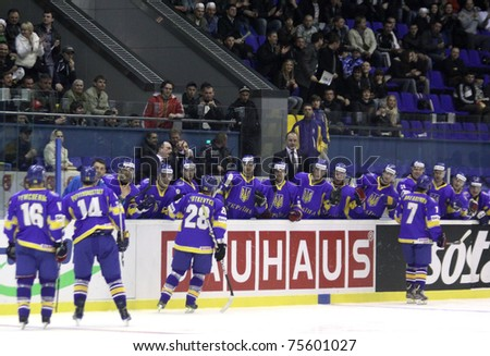 KYIV, UKRAINE - APRIL 18: Ukraine players react after they scored against Lithuania during their IIHF Ice-hockey World Championship DIV I Group B game on April 18, 2011 in Kyiv, Ukraine