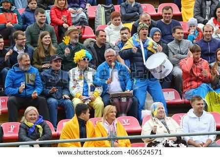 KYIV, UKRAINE - APRIL 16, 2016: Ukrainian supporters show their support during BNP Paribas FedCup World Group II Play-off game Ukraine vs Argentina at Campa Bucha Tennis Club in Kyiv, Ukraine - stock photo