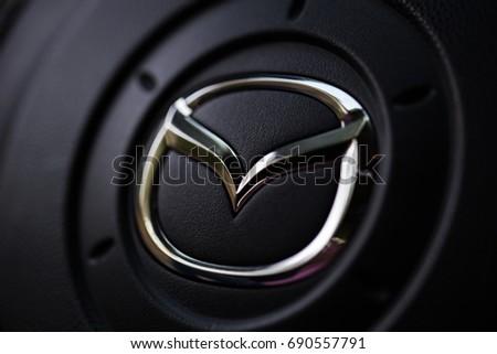 KYIV, UKRAINE - AUGUST 05, 2017: Mazda car logo on the steering wheel August 05, 2017
