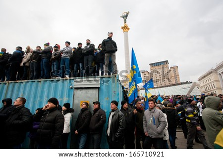 KYIV, UKRAINE - DEC 2: Crowd of the demonstrators occupying trailers standing on anti-government demonstration during the week of pro-European protest on December 2, 2013 in Kiev, Ukraine - stock photo