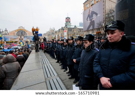 KYIV, UKRAINE - DEC 1: Faces of the police forces guarding the last monument of the communist leader Lenin during the pro-European protest on December 1, 2013 in the center of Kiev, Ukraine   - stock photo