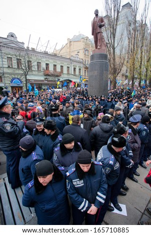 KYIV, UKRAINE - DEC 1: Huge police forces guarding the last monument of the communist leader Lenin during the pro-European protest on December 1, 2013 in the center of Kiev, Ukraine   - stock photo