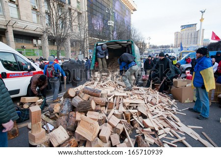 KYIV, UKRAINE - DEC 1: People harvest wood for fires, occupying main Maidan square for anti-government demonstration during the pro-European protest on December 1, 2013 in Kiev, Ukraine - stock photo