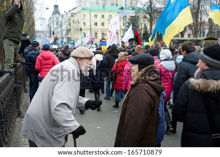 KYIV, UKRAINE - DEC 1: Two seniors talking about politics on anti-government demonstration during the pro-European protest on December 1, 2013 in the center of Kiev, Ukraine   - stock photo