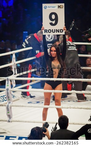 KYIV, UKRAINE - DECEMBER 13, 2014: Boxing ring girl holding a board with round number during WBO Intercontinental cruiserweight Title fight Oleksandr Usyk vs Danie Venter - stock photo