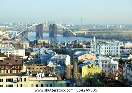 Kyiv, Ukraine - December 21, 2015 year. Winter urban landscape. Podil district of, Kiev, Ukraine - December 21, 2015 year. View of the historical district of Kiev Podol. The Dnieper River.