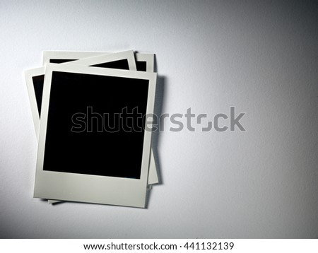 KYIV, UKRAINE - FEB 08, 2014: Polaroid photo cards on white. - stock photo