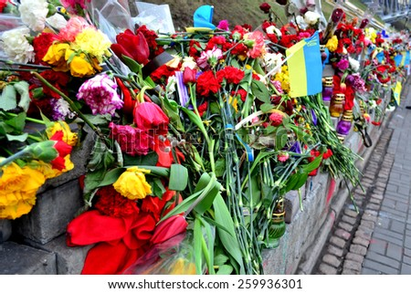 KYIV, UKRAINE - FEBRUARY 26 2015: Kyiv Maidan covered with flowers and candles in memory of victims of the shooting in February 2014, KIEV, UKRAINE.