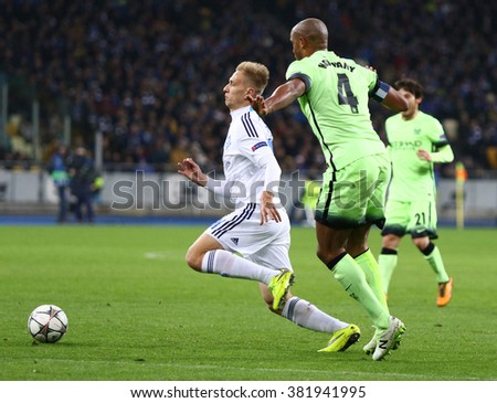 KYIV, UKRAINE - FEBRUARY 24, 2016: Lukasz Teodorczyk of Dynamo Kyiv (L) fights for a ball with Vincent Kompany of FC Manchester City players during their UEFA Champions League football match