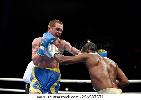 Kyiv, UKRAINE - February 27, 2015 : Volodymyr Matviichuk (Ukraine)  and Yasniel Toledo (Cuba) in the ring during boxing fight Ukraine Otamans vs Cuba Domadores in Palace of Sport in Kiev, Ukraine